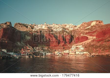 The country with harbor of Oia during sunset.