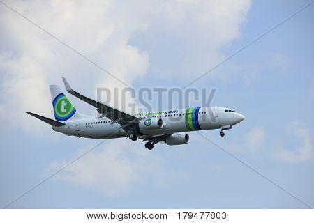 Amsterdam the Netherlands - March 31st 2017: PH-HSJ Transavia Boeing 737 approaching Polderbaan runway at Schiphol Amsterdam Airport the Netherlands