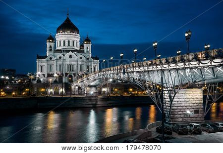 Cathedral of Christ the Saviour and Patriarshy bridge at night in Moscow, Russia