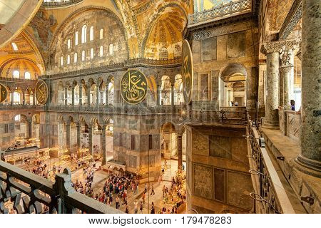ISTANBUL - MAY 25, 2013: Tourists visiting the Hagia Sophia in Istanbul. Hagia Sophia is the greatest monument of Byzantine Culture.