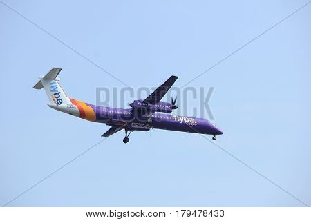 Amsterdam the Netherlands - March 31st 2017: G-PRPG Flybe De Havilland Canada DHC-8-400 approaching Polderbaan runway at Schiphol Amsterdam Airport the Netherlands