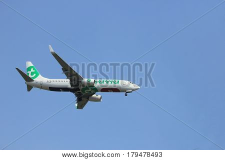 Amsterdam the Netherlands - March 31st 2017: PH-HXE Transavia Boeing 737 approaching Polderbaan runway at Schiphol Amsterdam Airport the Netherlands