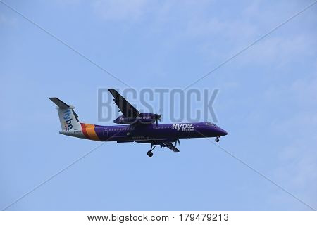 Amsterdam the Netherlands - March 31st 2017: G-PRPB Flybe De Havilland Canada DHC-8-400 approaching Polderbaan runway at Schiphol Amsterdam Airport the Netherlands