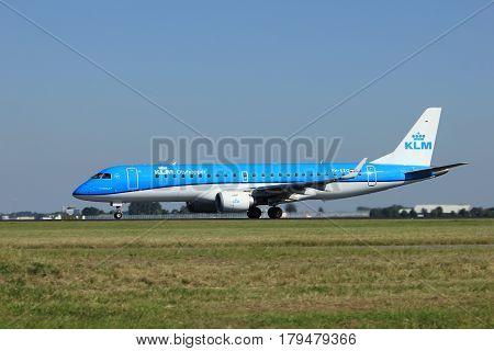 Amsterdam the Netherlands - August 18th 2016: PH-EZO KLM Cityhopper Embraer ERJ-190STD taking off from Polderbaan Runway Amsterdam Airport Schiphol