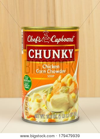 RIVER FALLS,WISCONSIN-APRIL 01,2017: A can of Chef's Cupboard brand chicken corn chowder with a wood background.