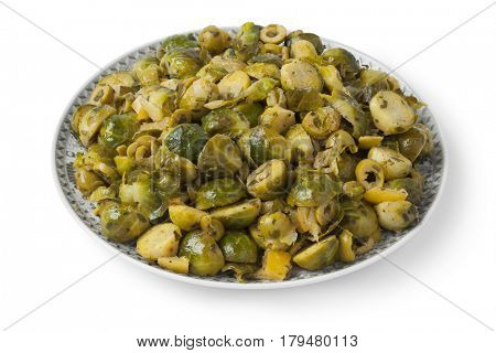 Moroccan dish with Brussels sprouts and preserved lemon on white background