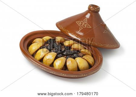 Traditional Moroccan festive oval tajine with meat, quinces and prunes isolated on white background