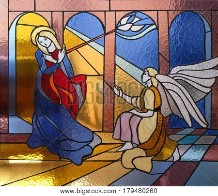 VAU I DEJES, ALBANIA - SEPTEMBER 30: Annunciation of the Virgin Mary stained glass window in Mother Teresa cathedral in Vau i Dejes, Albania on September 30, 2016.