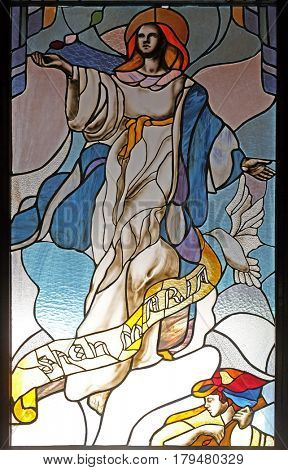 VAU I DEJES, ALBANIA - SEPTEMBER 30: Assumption of Virgin Mary stained glass window in Mother Teresa cathedral in Vau i Dejes, Albania on September 30, 2016.