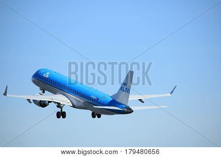 Amsterdam the Netherlands - March 25th 2017: PH-EZU KLM Cityhopper Embraer ERJ-190 takeoff from Polderbaan runway.
