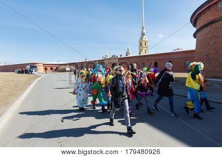 Saint-Petersburg, Russia - April 1, 2017: Procession of clowns on Funny festival XVI on Peter and Paul Fortress territory