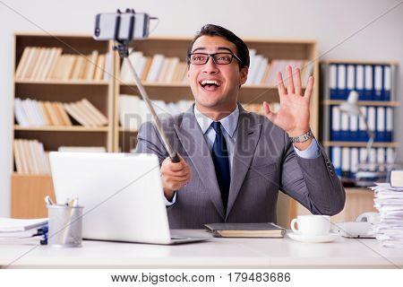 Businessman taking selfie in the office