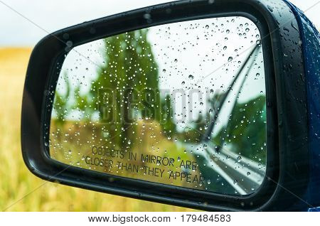 Rear-view Mirror With Water Drops
