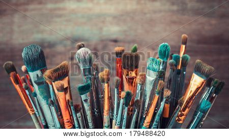 Bunch Of Artistic Paintbrushes. Retro Toned Photo.
