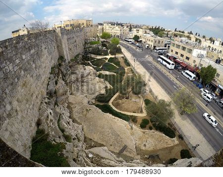 JERUSALEM ISRAEL - MARCH 25 2017: Northern wall of the old city of Jerusalem and Sultan Suleiman street