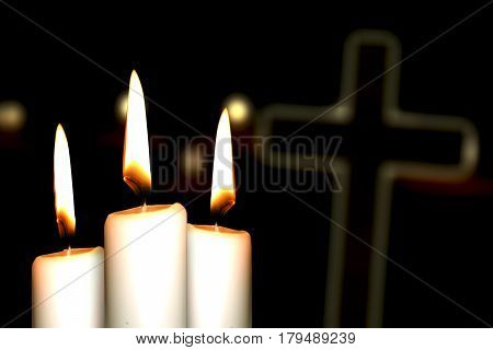 Image of three candles glowing with a cross symbol on the background
