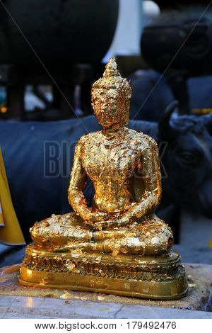 Gold leaf on a small budha statue