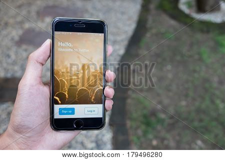 CHIANG MAI THAILAND - FEB 03 2016: Person holding a brand new Apple iPhone with Twitter logo on the screen. Twitter is a social media online service for microblogging and networking communication.
