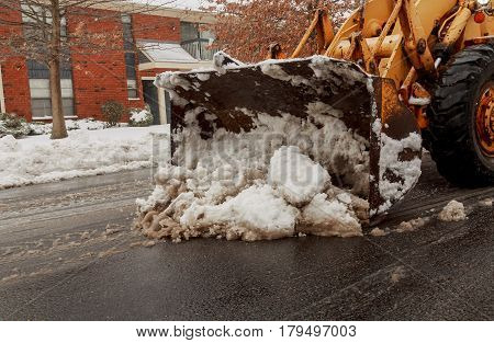 Snow removal vehicle removing snow Snow-plow tractor