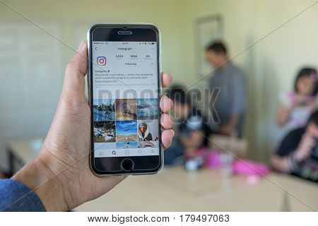 CHIANG MAI THAILAND - NOV 23 2016: A man hand holding iphone with new logo of instagram application. Instagram is largest and most popular photograph social networking.