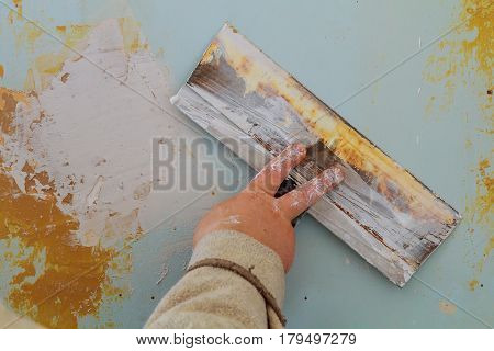 The process of applying the second layer of putty trowel for light plaster walls wall putty to defective