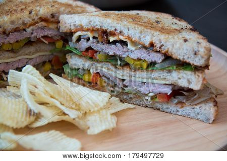 Clubhouse sandwich closeup with tomatoes chip potato