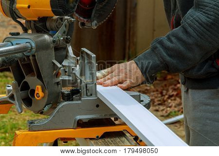 circular saw for cutting wood Circular Saw. Carpenter Using Circular Saw for wood