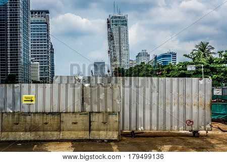 A zinc fence covering construction area from public photo taken in Jakarta Indonesia java