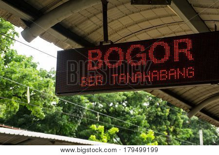 Display information board hanging on ceiling showing train to Bogor will entering the station soon photo taken in Jakarta Indonesia java