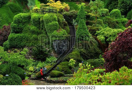 Butchart Gardens in the rainy day. Beautiful gardens on Vancouver Island, world-famous masterpiece of landscape architecture.