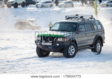 KHABAROVSK RUSSIA - JANUARY 28 2017: Mitsubishi Pajero Sport riding on snow during local championship