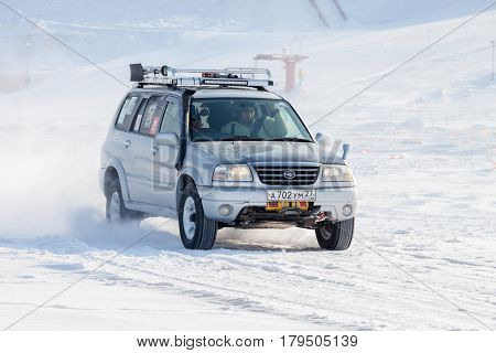 KHABAROVSK RUSSIA - JANUARY 28 2017: Suzuki Escudo riding on snow during local championship