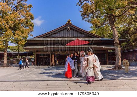 TOKYO, JAPAN - APRIL 19, 2014: Japanese wedding ceremony at Shrine on April 19, 2014. As Meiji Jingu Shrine It's possible to see wedding parties parading through the inner ground of the shrine