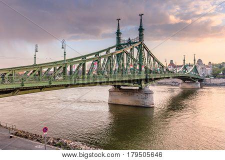 BUDAPEST, HUNGARY - APRIL 13, 2016: Liberty Bridge in sunset in Budapest. The Liberty Bridge is the third southernmost public road bridge in Budapest.