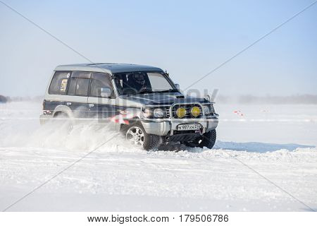 KHABAROVSK RUSSIA - JANUARY 28 2017: Mitsubishi Pajero riding on snow during local championship