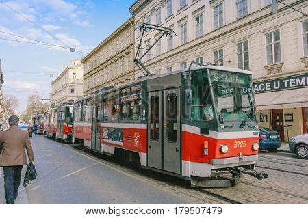 PRAGUE, CZECH REPUBLIC - APRIL 14, 2016: Tram at old street in Prague Czech Republic on April 14, 2016. Prague historical Center including most of the city major sites became a UNESCO-listed site in 1992