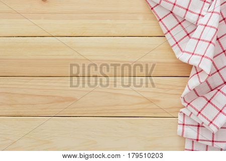 Tablecloth textile checkered picnic napkin on wooden table background Top view with blank space and text.