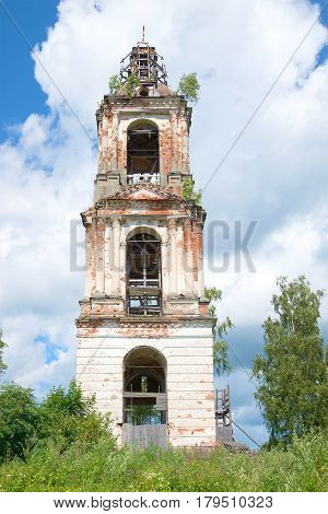 Abandoned bell tower of St. Nicholas Cathedral closeup of a July afternoon. The village of Nikolo-Korma. Yaroslavl region, Russia
