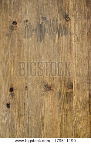 Cracked weathered brown painted wooden board texture.