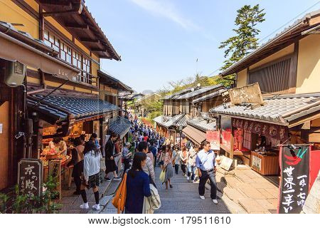 KYOTO JAPAN - APRIL 19 2015: Tourists walk on a street around Kiyomizu Temple. Kiyomizu is a famous temple in Kyoto built in year 778. That is part of the Historic Monuments of Ancient Kyoto Japan