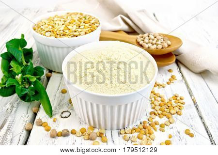 Flour Pea And Split Pease In Bowls And Spoons On Board