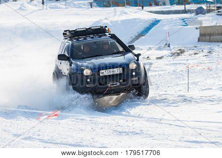 KHABAROVSK RUSSIA - JANUARY 28 2017: Isuzu Vehicross riding on snow during local championship