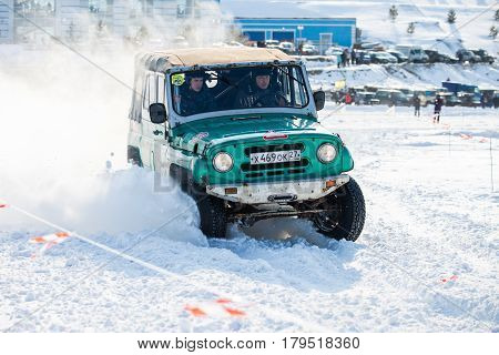 KHABAROVSK RUSSIA - JANUARY 28 2017: UAZ 469 riding on snow during local championship