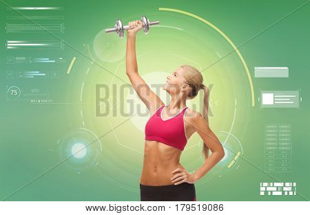 sport, fitness, exercising, technology and people concept - happy young sporty woman with dumbbells flexing biceps over green background