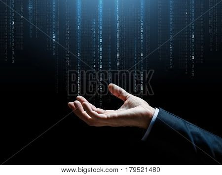 business, technology, cyberspace and people concept - close up of businessman hand with binary code projection over dark background