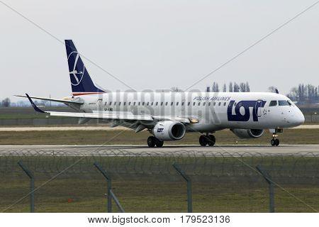 Borispol, Ukraine - March 25, 2017: Dniproavia Embraer ERJ-145 aircraft landing on the runway to Borispol International Airport on March 25, 2017. Editorial use only
