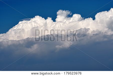Huge cumulus clouds over blue sky for background use