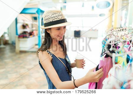 Woman shopping and enjoy her coffee