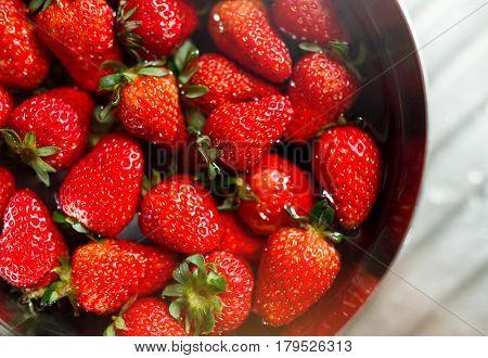 Strawberry soaking in water