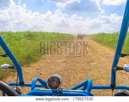 Dirt road of Cumayasa, near La Romana and Catalina Island, from the Buggy. Enjoy the landscapes of Dominican Republic during a Buggy ride. The Buggy ride is a popular tour in Cumayasa area.